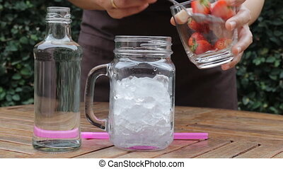 Strawberry infused water easy drink, stock video