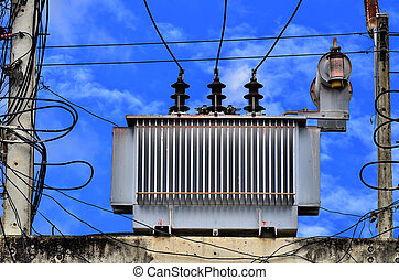 High voltage power transformer on blue sky background