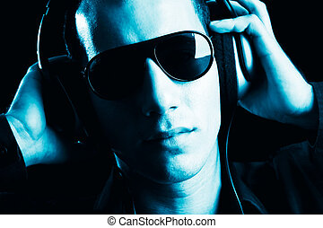 Disco man - Portrait of a fashion guy listening music with...