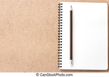 Open Small notepad with pencil and on wood background