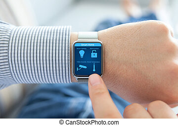 Man hands with watch and smart home on the screen
