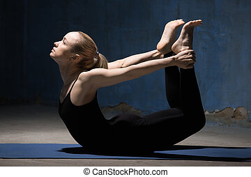 Beautiful Yoga Woman Doing Bow Pose - Beautiful sporty fit...