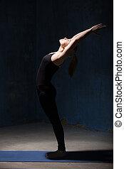 Beautiful Yoga Woman Doing Ardha Chakrasana Pose - Beautiful...