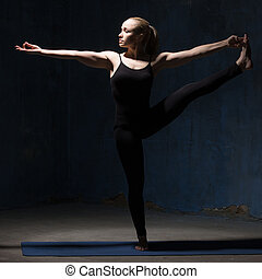 Beautiful Yoga Woman Doing Extended Hand to Big Toe pose -...