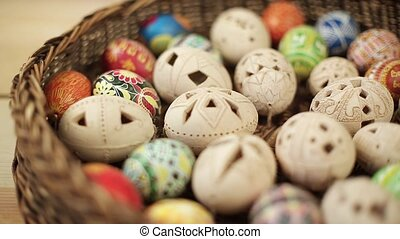Easter eggs rolling on green background