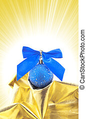 Blue Christmas ball with a bow on a gold background