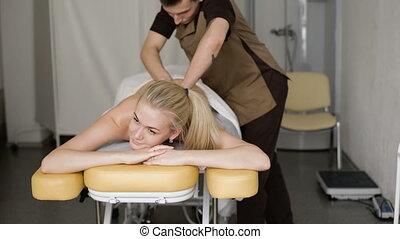 Woman in massage Young attractive blonde woman smiling with...
