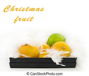 Christmas fruit in a black box with white feathers in the form of snow