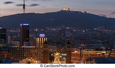 View of the Venetian Tower on Espanya square day to night timelapse, Tibidabo on background. barcelona. Spain.
