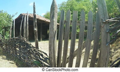 Wooden fence in front of wooden house - Steadicam camera on...