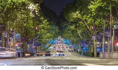rush of night time traffic on road timelapse in barcelona,...