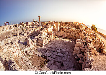 The Episcopal Precinct of Kourion illuminated by the last...