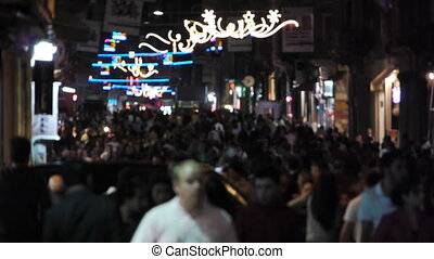 Crowded street at night. - Thousands of people walking on a...