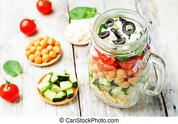 Pasta chickpeas cucumber tomatoes spinach goat cheese salad...