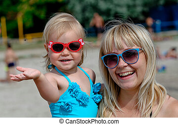 little girl and her mother have a good time at the seaside...