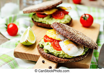 smashed avocado, tomatoes, egg sandwich. toning. selective...
