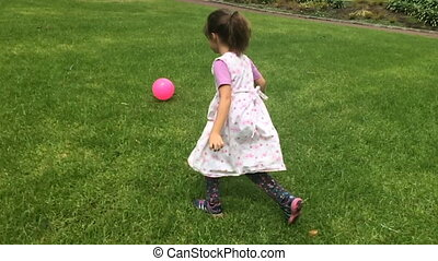 Happy girl play with a ball - Slow motion happy girl play...