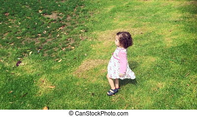 Little girl run on green grass Children childhood concept