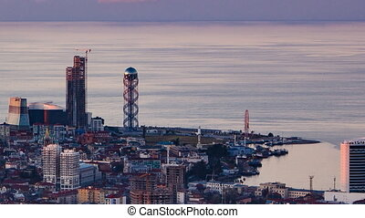 Sunset timelapse Batumi cityscape pan right
