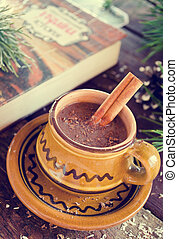 Hot chocolate with cinnamon in a rustic ware. Christmas...