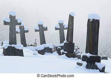 Snow Covered Cemetery Crosses