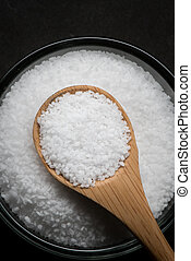 Wooden Spoon of Sea Salt with Glass Bowl of Salt