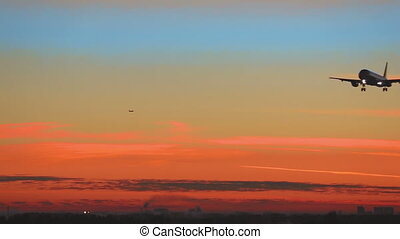 Airplane approaching at dawn