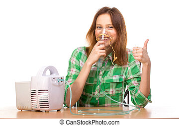 Woman thumbs up with inhaler - Young girl using nebulizer...