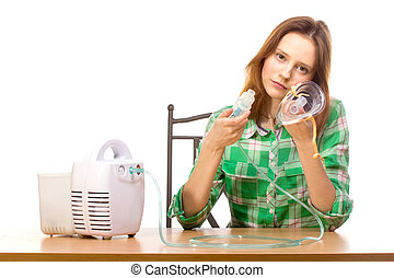 Woman with inhaler - Young girl using nebulizer mask for...