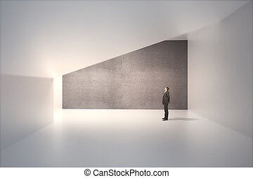 Concrete wall and businessman - Sunlit interior design with...