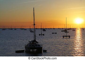 Yachts in a bay at sunset in Darwin, Australia