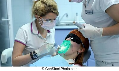 Drying Inlays with UV Curing Light in Dental Procedure