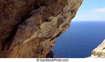 The cliff line of Mallorca with deep blue water of the...