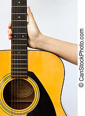 Woman's hand holding acoustic guitar on white background
