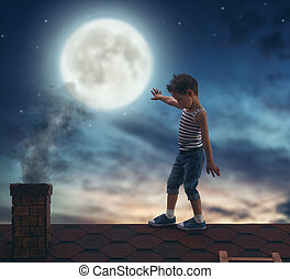 boy walks on the roof - Child boy walks on the roof in the...