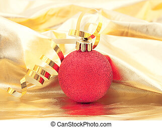 Shining christmass ball on a gold bacground