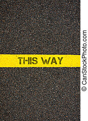 Road marking yellow line with text THIS WAY - Road marking...