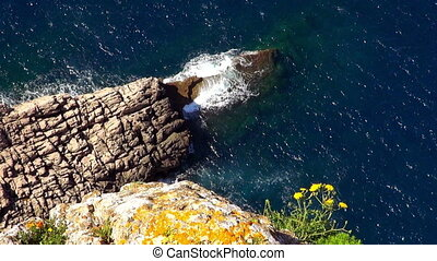 The Colorful Cliff line of Mallorca breaking ocean waves
