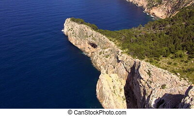 The cliff line of Mallorca with deep blue water of the Mediterranean sea