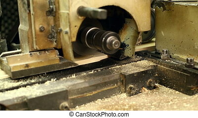 View of milling cutter and board on conveyor, close-up