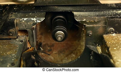 Woodshop. Close-up on milling cutter of machine - Woodshop....