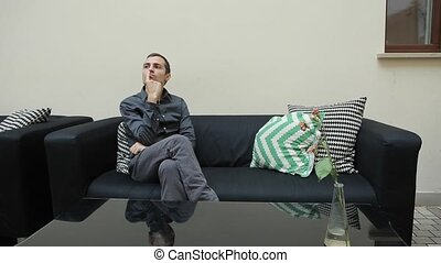 Technology, People, Lifestyle and Communication Concept of Man with Smartphone and Sitting on Couch