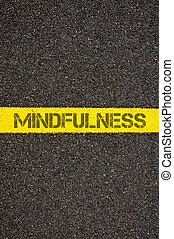 Road marking yellow line with word MINDFULNESS - Road...