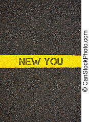 Road marking yellow line with words NEW YOU - Road marking...