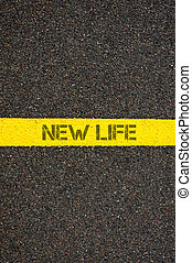 Road marking yellow line with words NEW LIFE - Road marking...