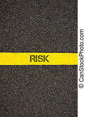 Road marking yellow line with word RISK - Road marking...