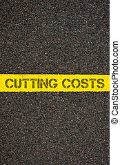 Road marking yellow line with words CUTTING COSTS - Road...