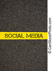Road marking yellow line with words SOCIAL MEDIA - Road...