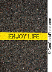 Road marking yellow line with words ENJOY LIFE - Road...