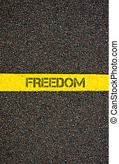 Road marking yellow line with word FREEDOM - Road marking...